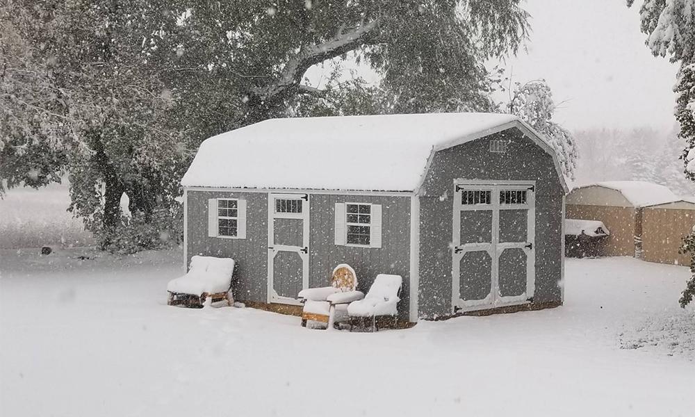 Beautiful dutch barn storage sheds in snow