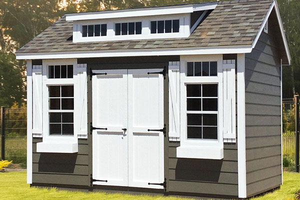 Classic shed with wood lap siding for home studio shed