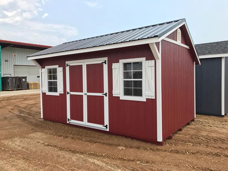 Quaker shed with wood panel siding