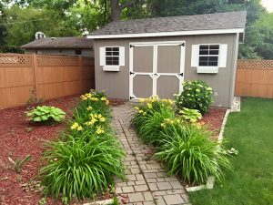 Outdoor storage shed with vinyl siding for sale